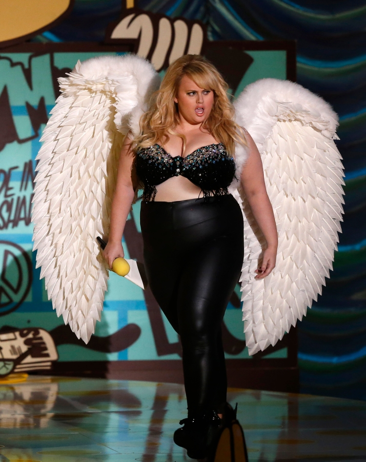 "Actress Rebel Wilson walks on stage to join her co-stars from ""Pitch Perfect 2"" as they present an award at the 2015 MTV Movie Awards in Los Angeles"